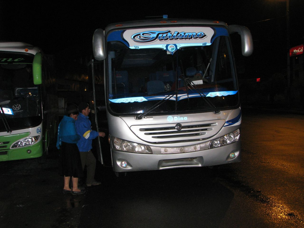 Baltazar and his family board a bus to the Quito airport