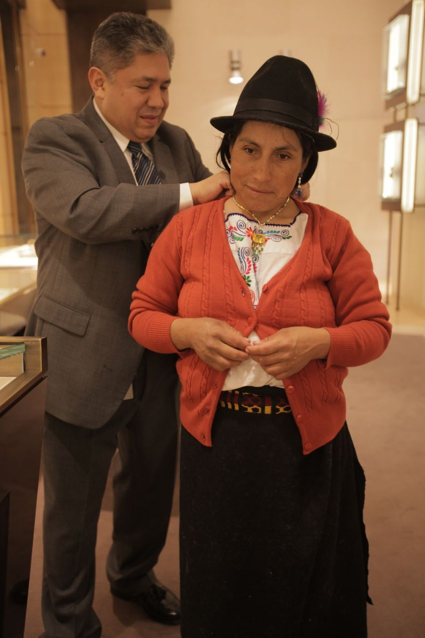 A Colombian man lets Carmen try on Jewelry at Bulgari
