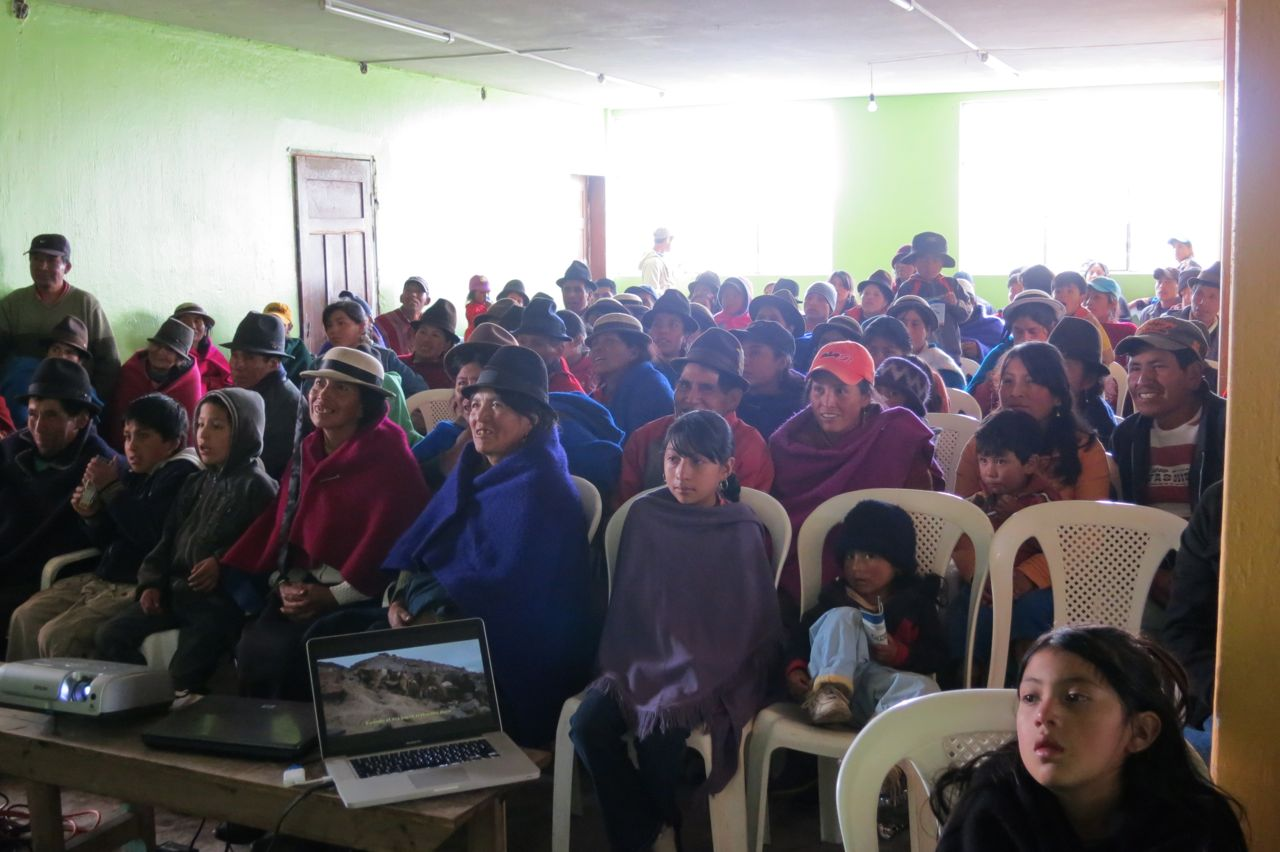 An audience enjoys the movie in Pulingui