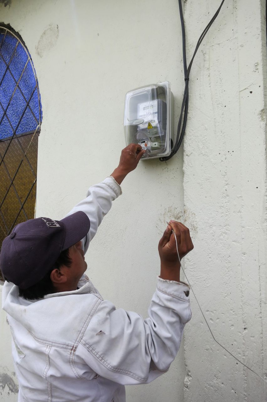 Hooking up electricity for a screening in Cuatro Esquinas